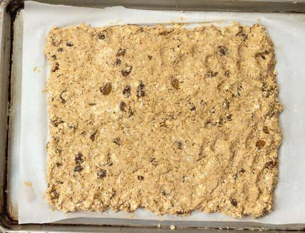 Oatmeal Rosemary Scone dough patted into rectangle on baking sheet
