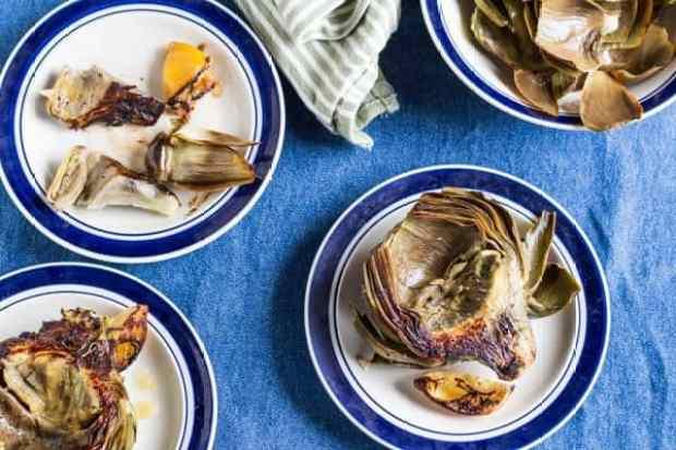 Lemon Roasted Artichokes on plates partially eaten