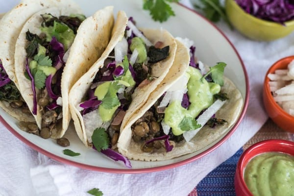 Spicy Greens and Lentil Tacos with Guacamole Sauce.