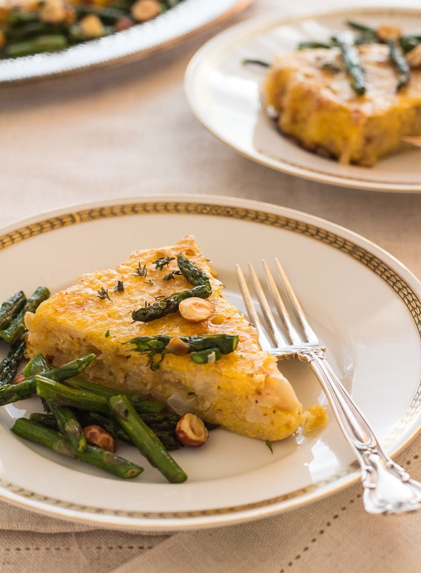 one slice of Polenta Cauliflower Torta with Roasted Asparagus | Letty's Kitchen
