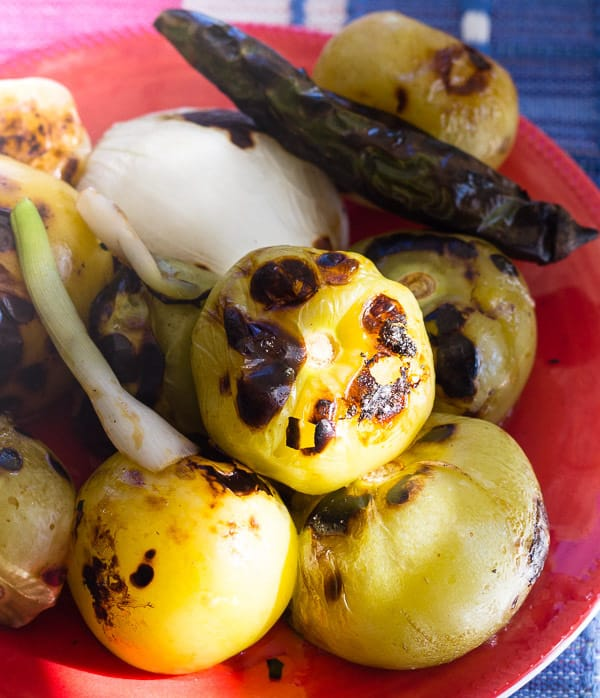 charred ingredients for Roasted Green Tomatillo Salsa