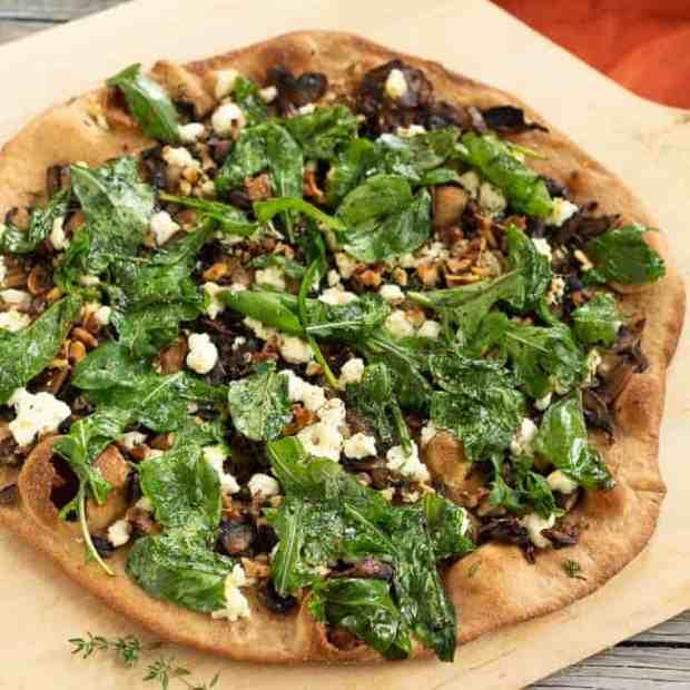 Caramelized Mushroom and Arugula Pizza Bianca done and uncut