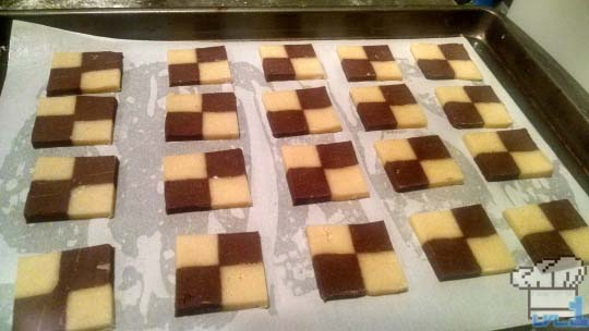 Sliced checkerboard cookies on pan and ready to be baked off.