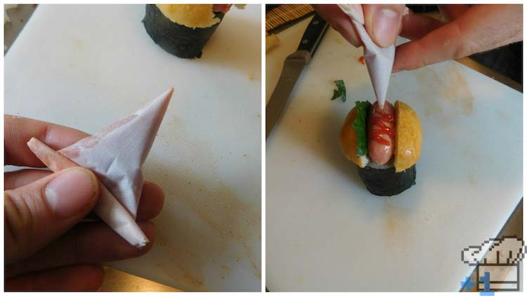 Piping ketchup onto the hot dog sushi tops for garnish and flavor.