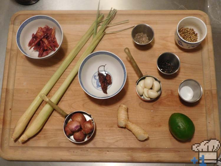All of the Superspicy Curry recipe ingredients are lined up to be prepared.