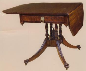 SHERATON LIBRARY TABLE WITH ACANTHUS CARVING, SWAGS  AND A PINEAPPLE FINIAL