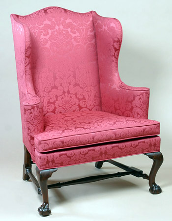 CHIPPENDALE BALL AND CLAW FOOT WING CHAIR WITH VERTICAL SCROLLED ARMS