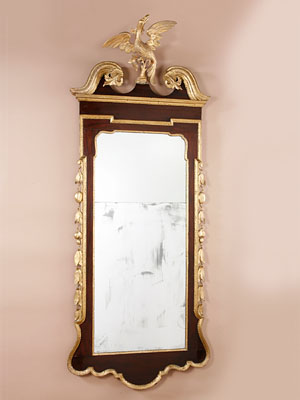 CHIPPENDALE MIRROR WITH SIDE CARVINGS AND CARVED PHOENIX FINIAL
