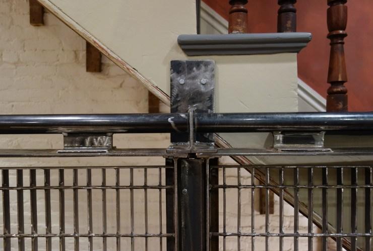 Subway Grate Guardrail (2016) installed, bracket detail