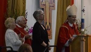 Bishop Michael F. Burbidge presents the Lewis Award to Mrs. Joan Troy