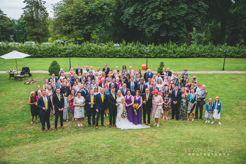 Group photo of all guests at wedding
