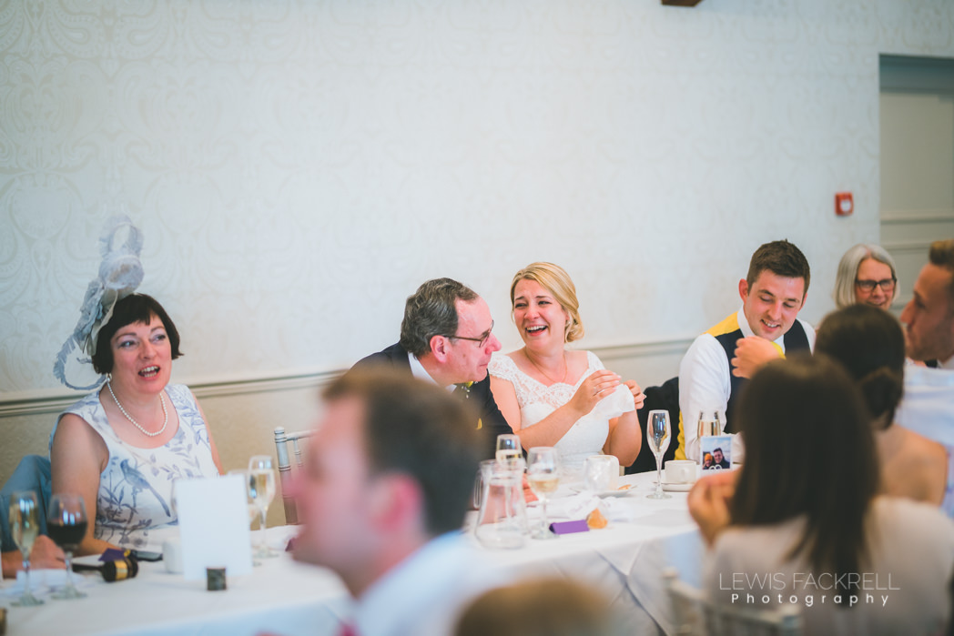 Laughter between bride and her dad