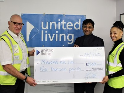 Handing over a cheque to a social value project