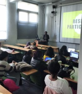 Tosin gives a talk to LMU students