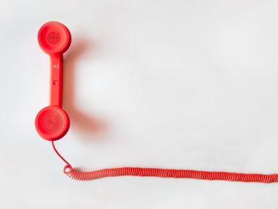 A red telephone with red spiral chord