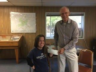 Dr. Rick Serns, Superintendent of Winlock Schools, receives a donation check from Jillian Brockmoller. Photo courtesy: Windermere Centralia.