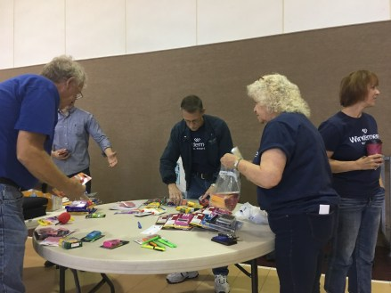 Windermere Centralia agents and staff help stuff backpacks with school supplies for local kids. Photo courtesy: Windermere Centralia.