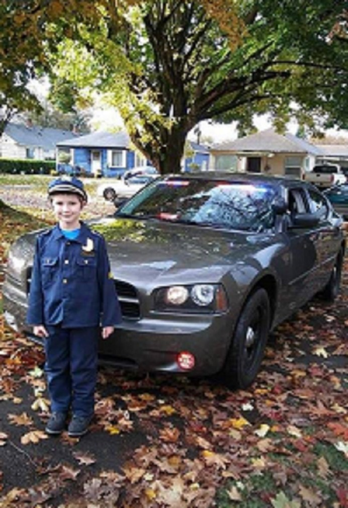 Damon poses with Pennington's patrol car. Photo courtesy: Randy Pennington.