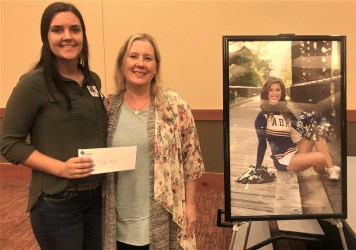 Olivia Mitchell Scholarship recipient Taylor Rolfe with Suzie Mitchell. The award is given in memory of Olivia Mitchell. Photo credit: Centralia Chehalis Chamber of Commerce.