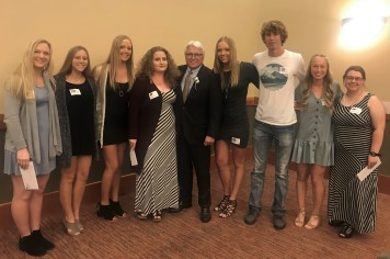 Rob Fuller Scholarship recipients Liliyana Erickson; Lexis Haller; Sarah Haakenson; and Nicole Allen; with Tom O'Keefe, keynote speaker and financial donor; recipients Madeline Haakenson; Colby White; Makayla Erickson; and Tessa Smith. Photo credit: Centralia Chehalis Chamber of Commerce.