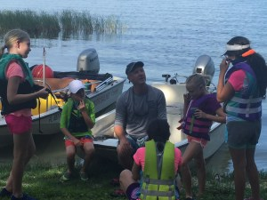 Coach with a group of Opti sailors