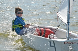 Young Sailor in an Optimist sailboat on Lake Eustis.
