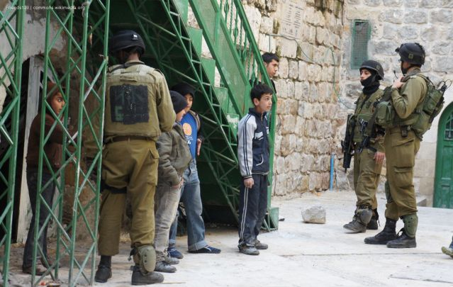 Soldiers detaining children in Hebron, 4th February 2012.