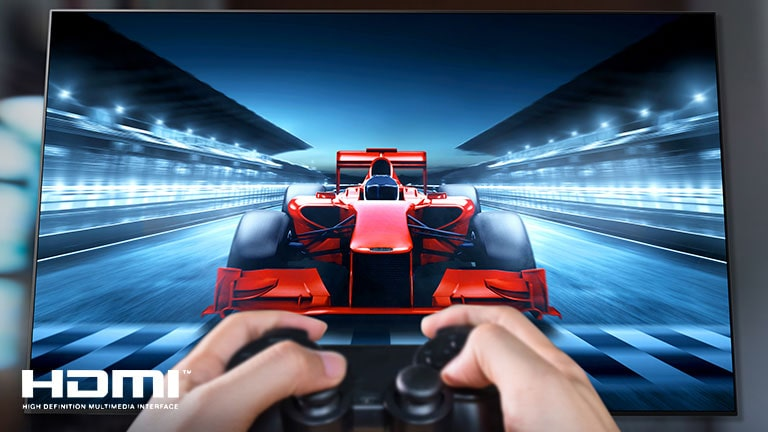 A close up of a player playing a racing game on a TV screen. On the image, there are HDMI logo on the bottom left.