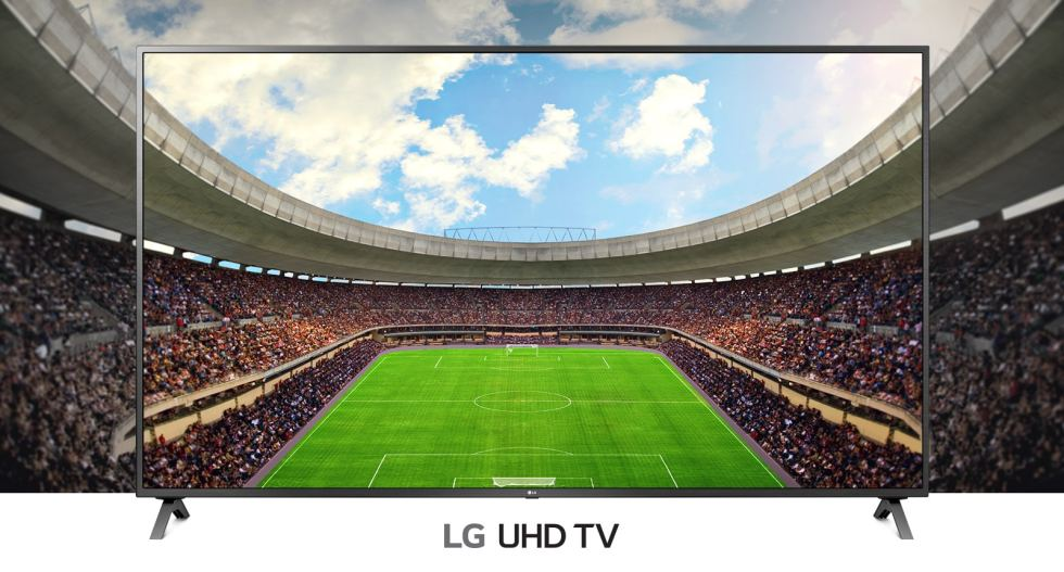 A panoramic view of the soccer stadium filled with spectators shown inside a TV frame.
