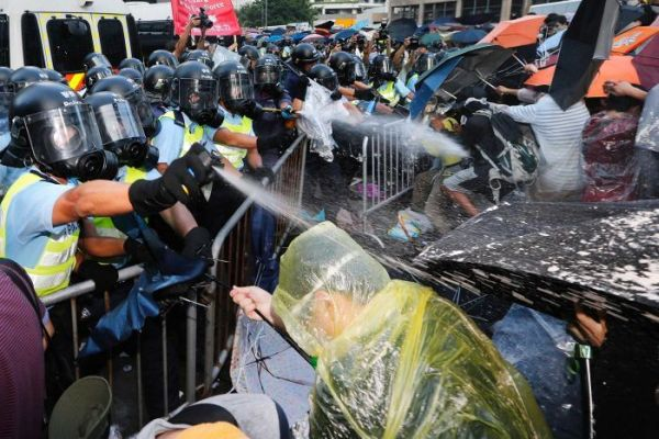 Police and protesters clash in Hong Kong