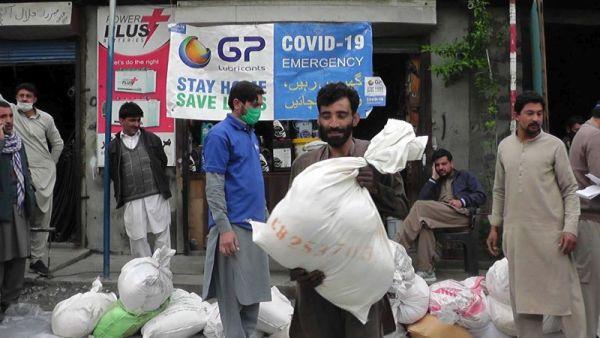 Philanthropists distributed relief goods among mechanics at motor workshops