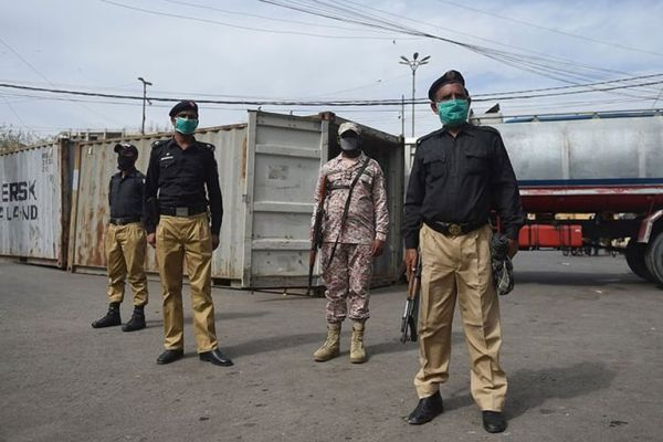 Security personnel wearing facemasks