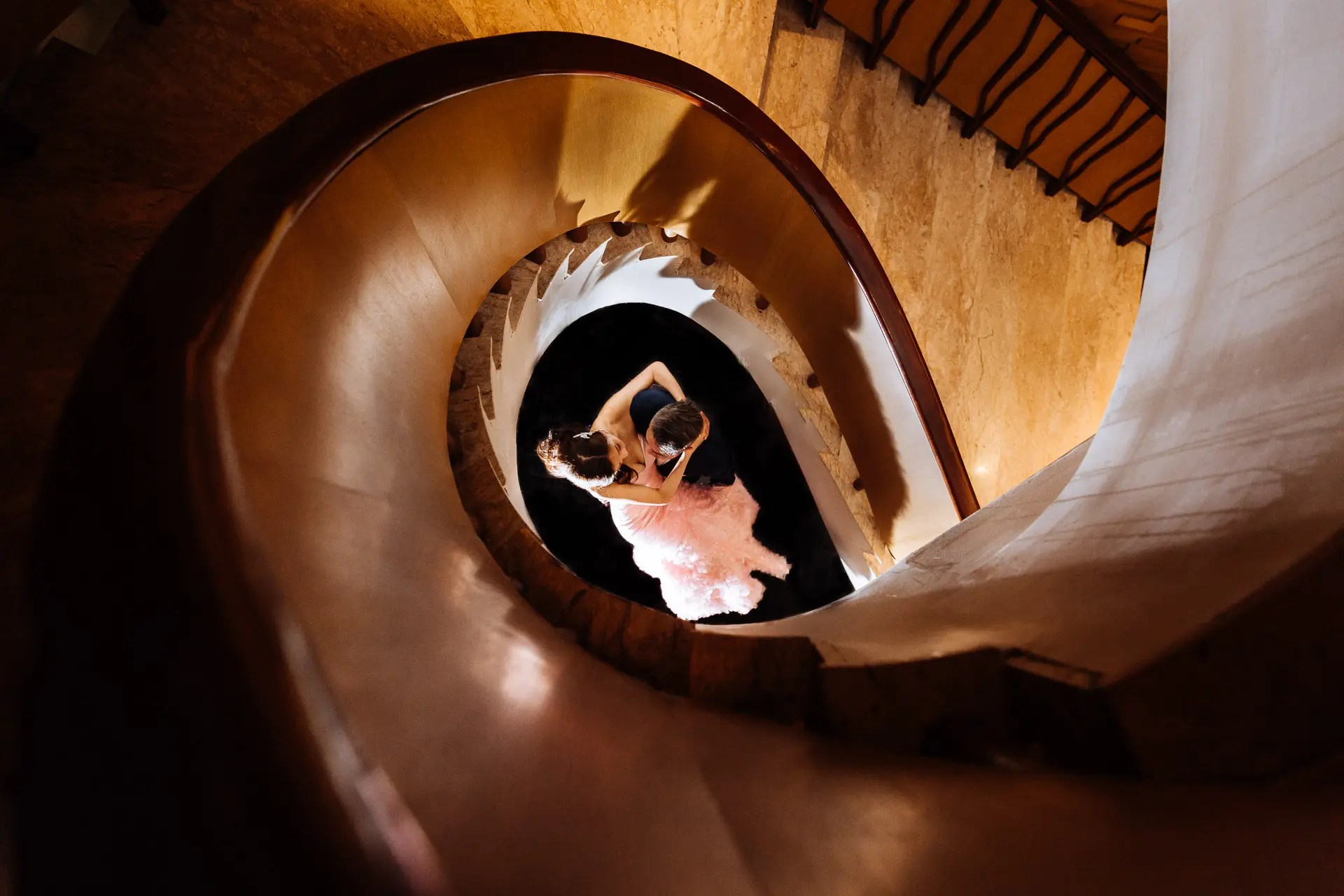 View of bride and groom from spiral staircase