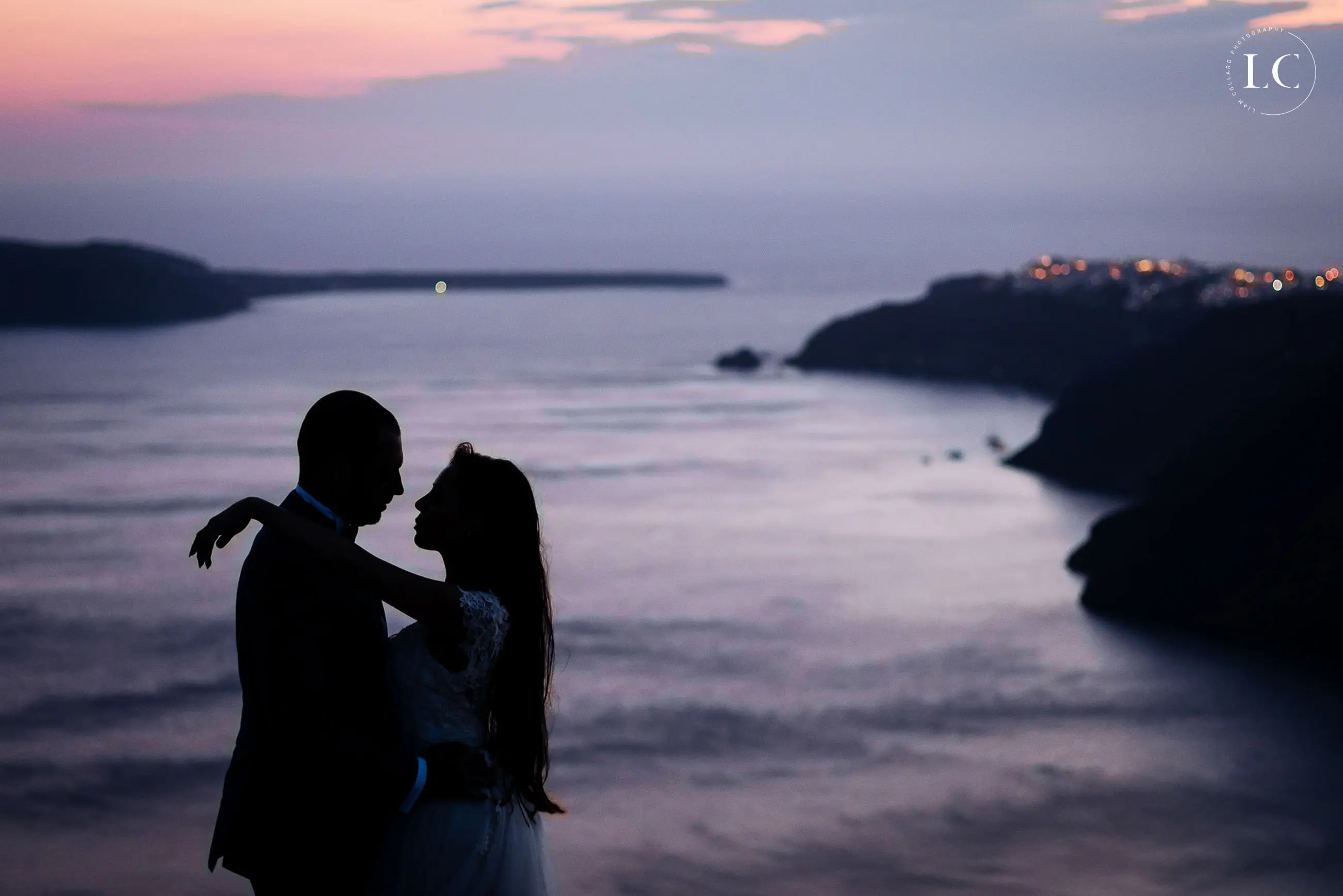 Silhouette of bride and groom at dusk
