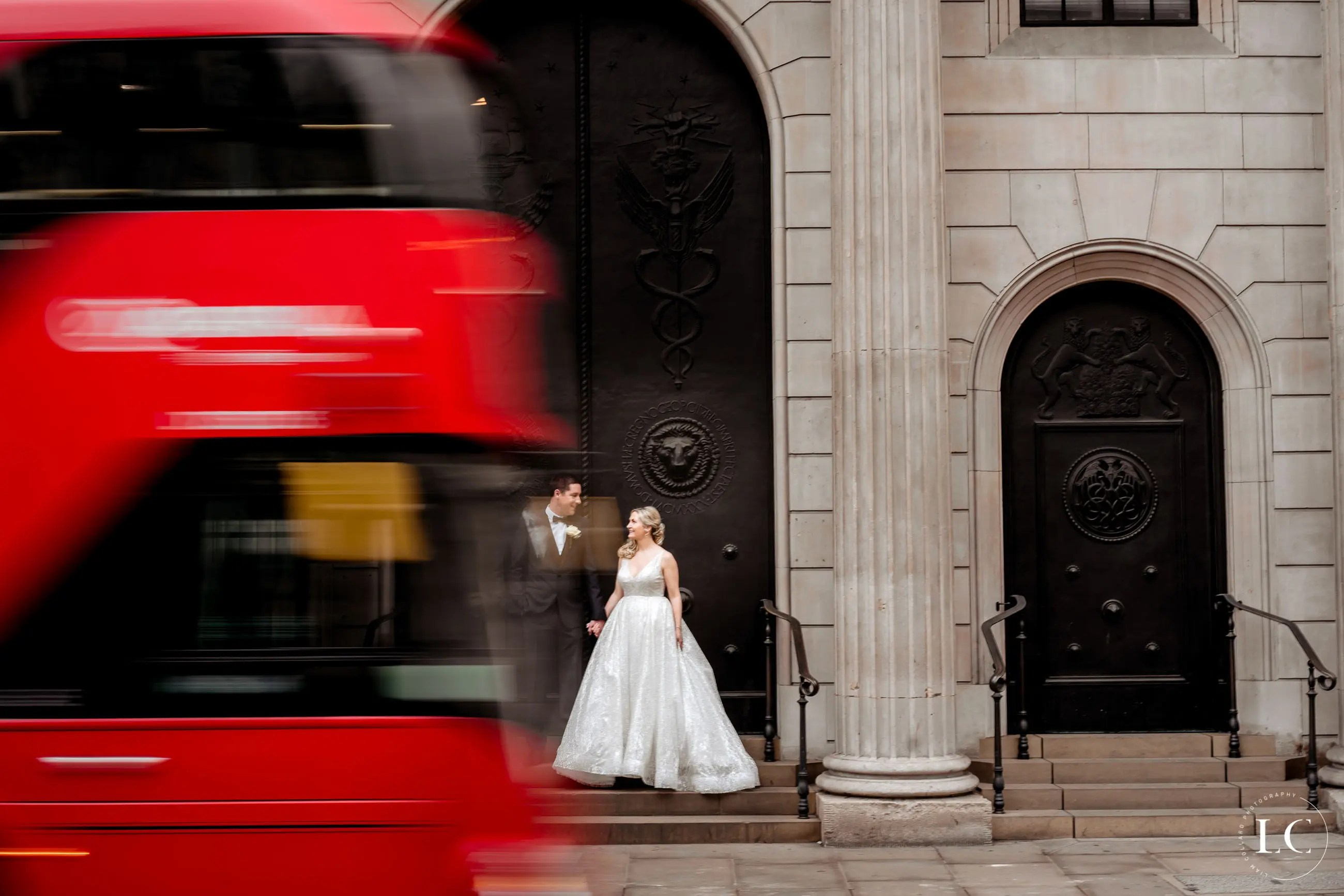 Bride and groom with London bus