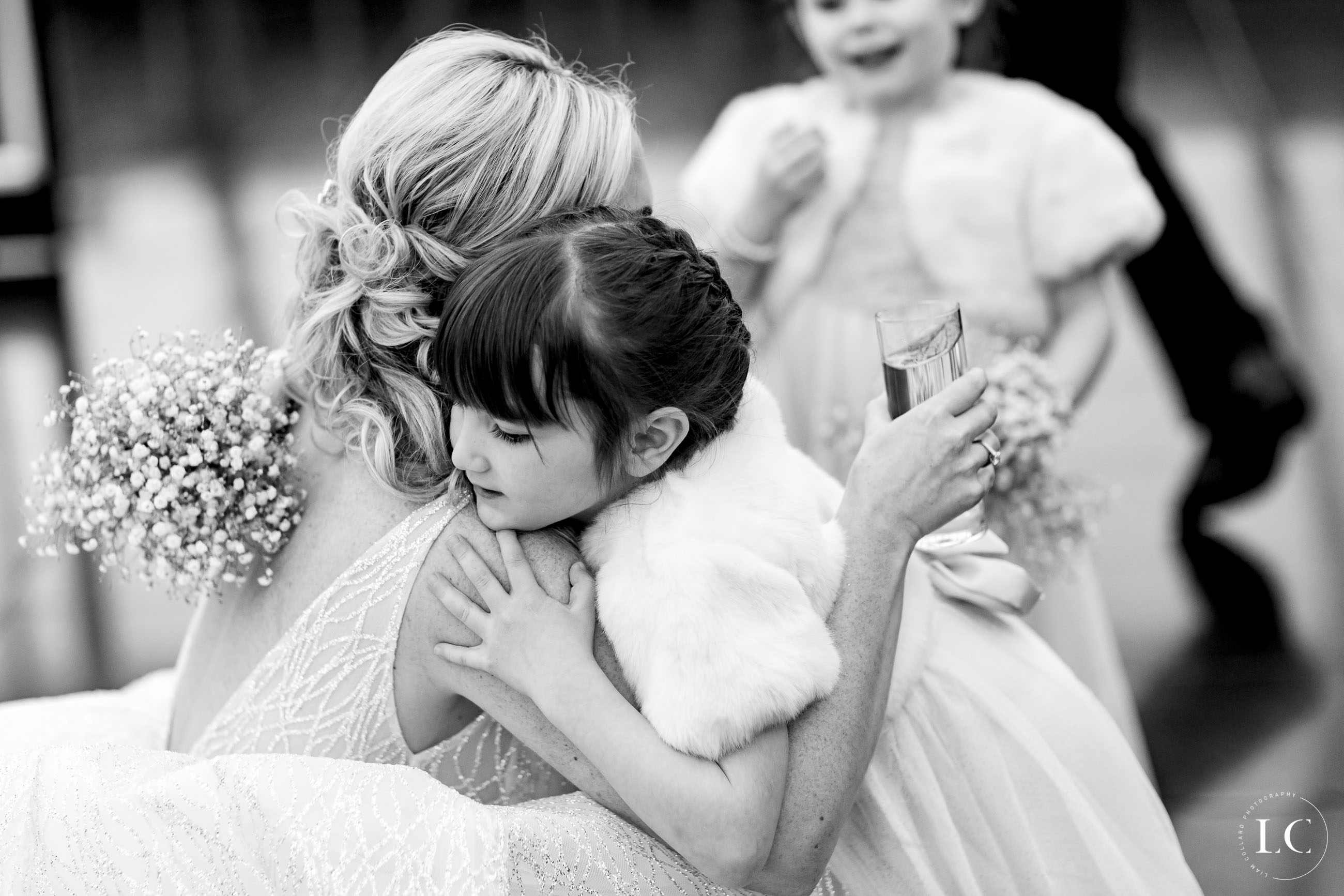 Bride and child hugging