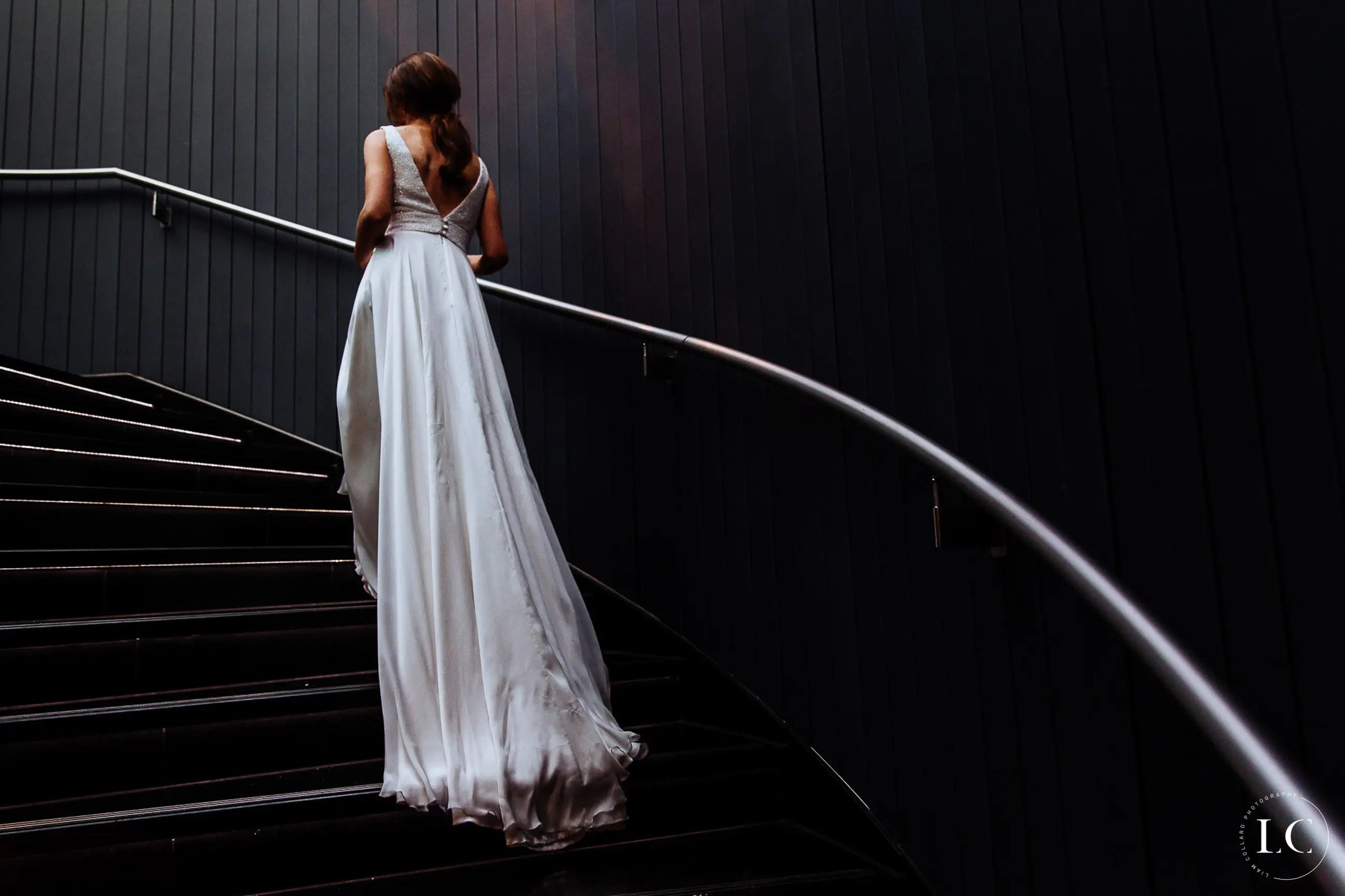 Bride walking up staircase