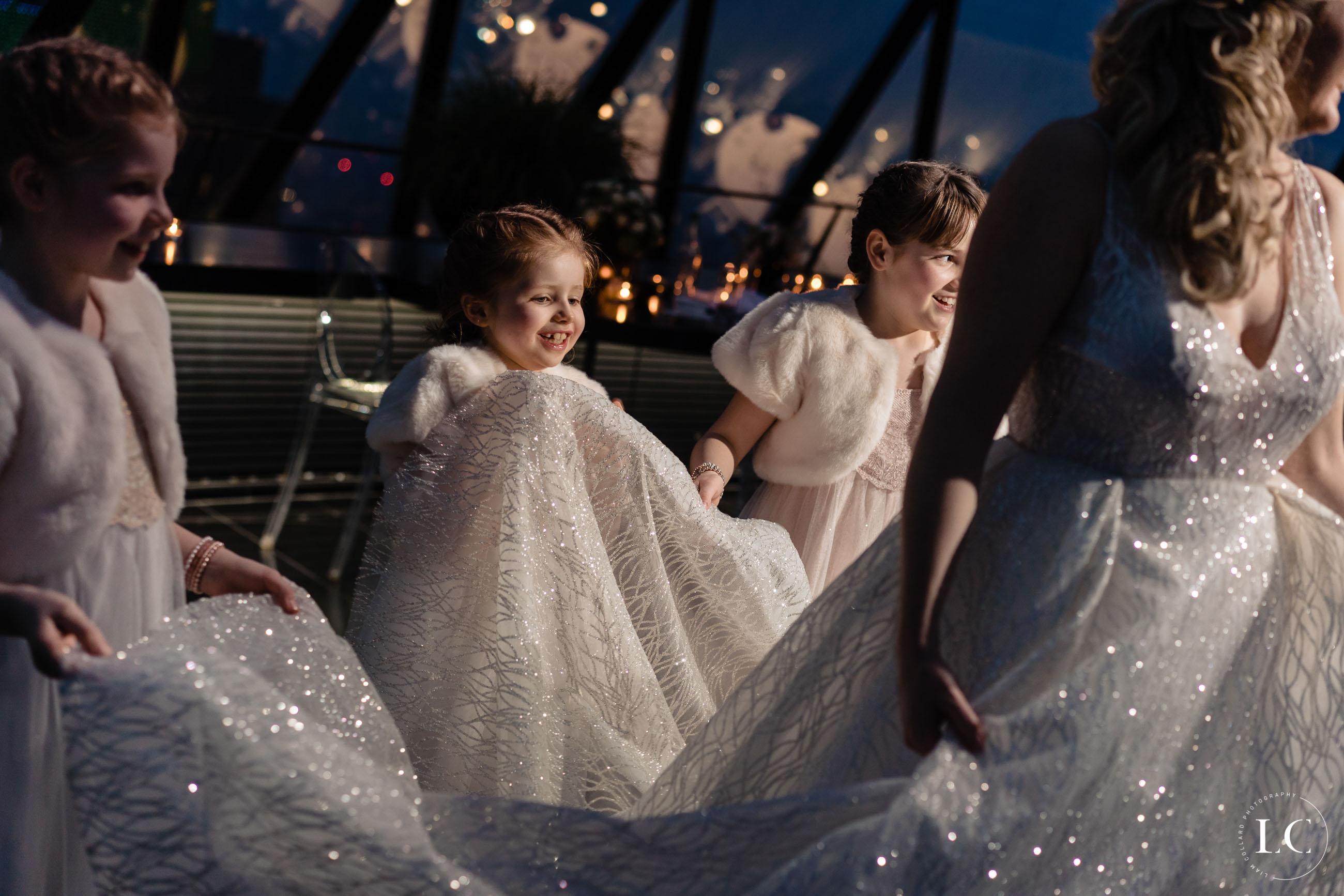 Child touching wedding dress