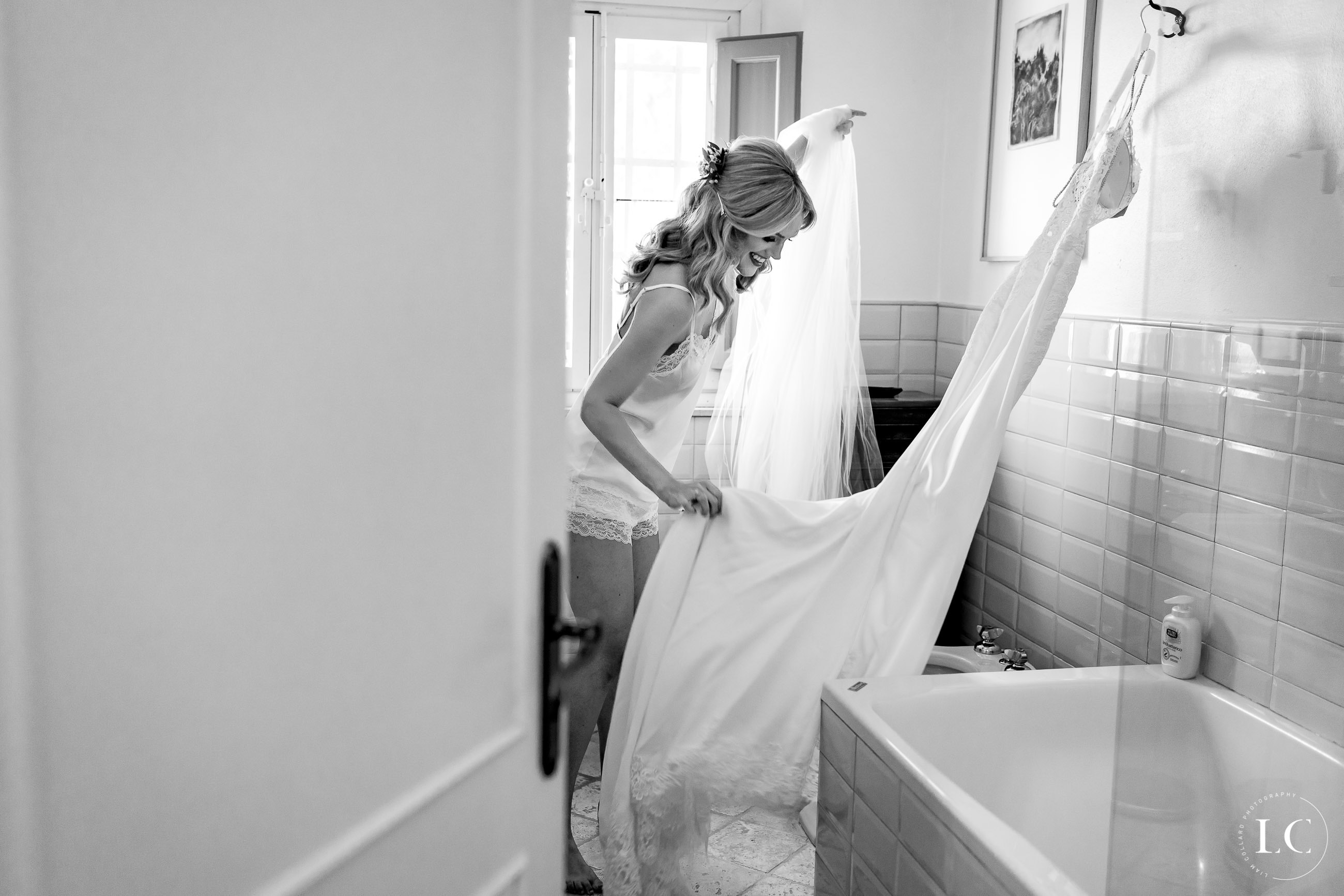 Bride holding dress