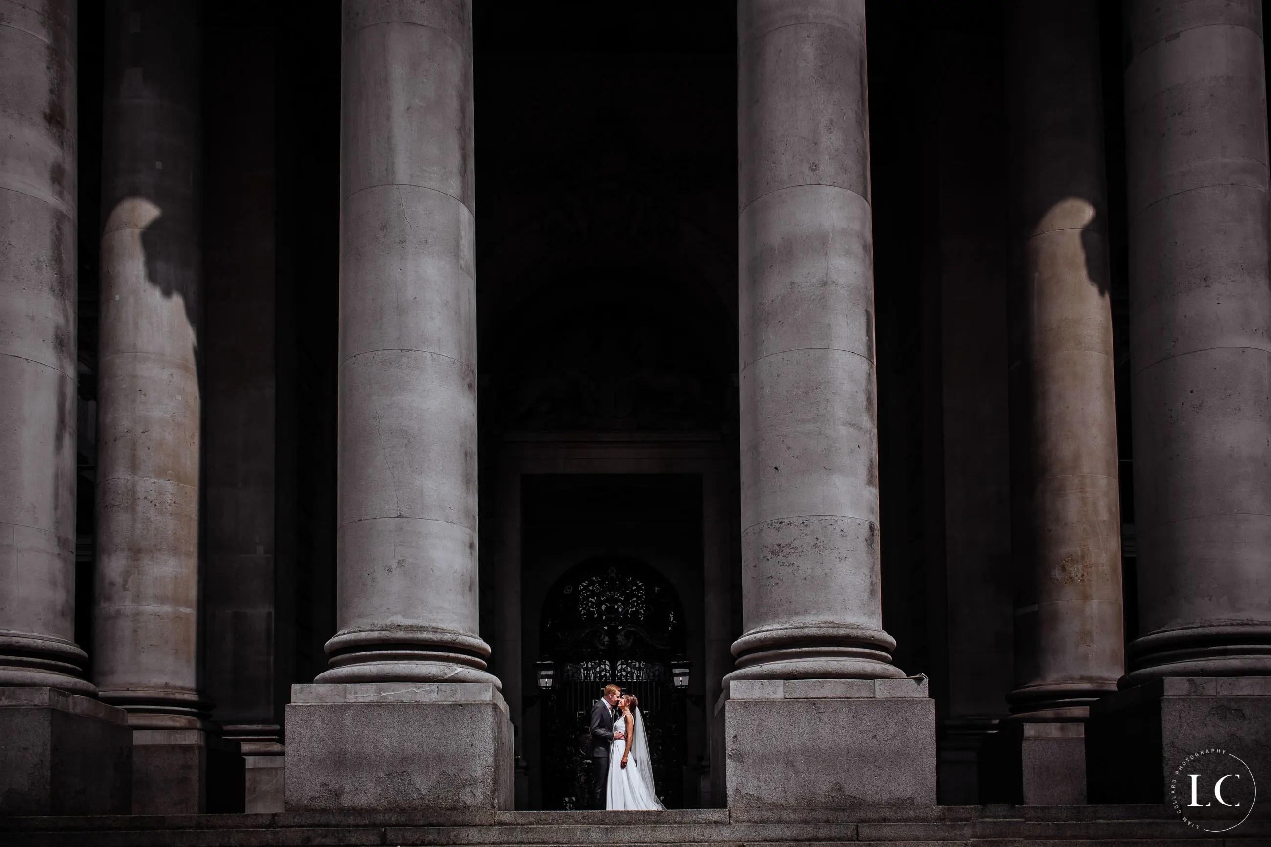 Pillars far angle of bride and groom