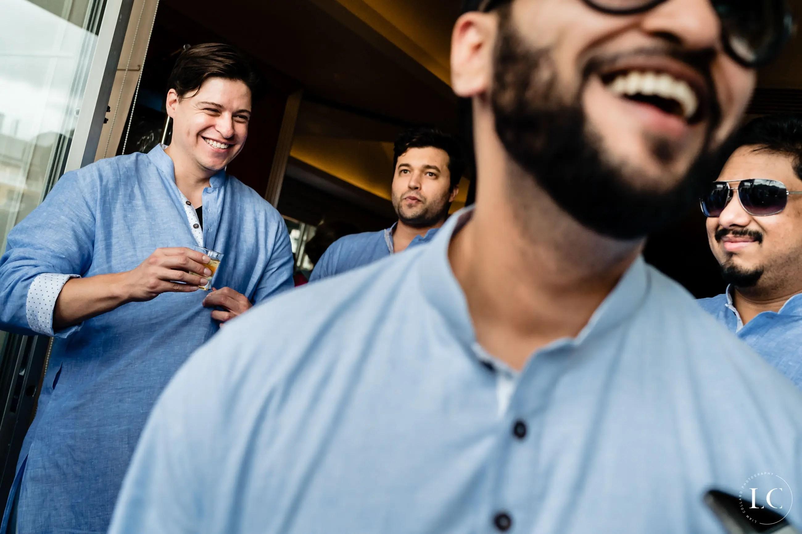 People laughing at wedding