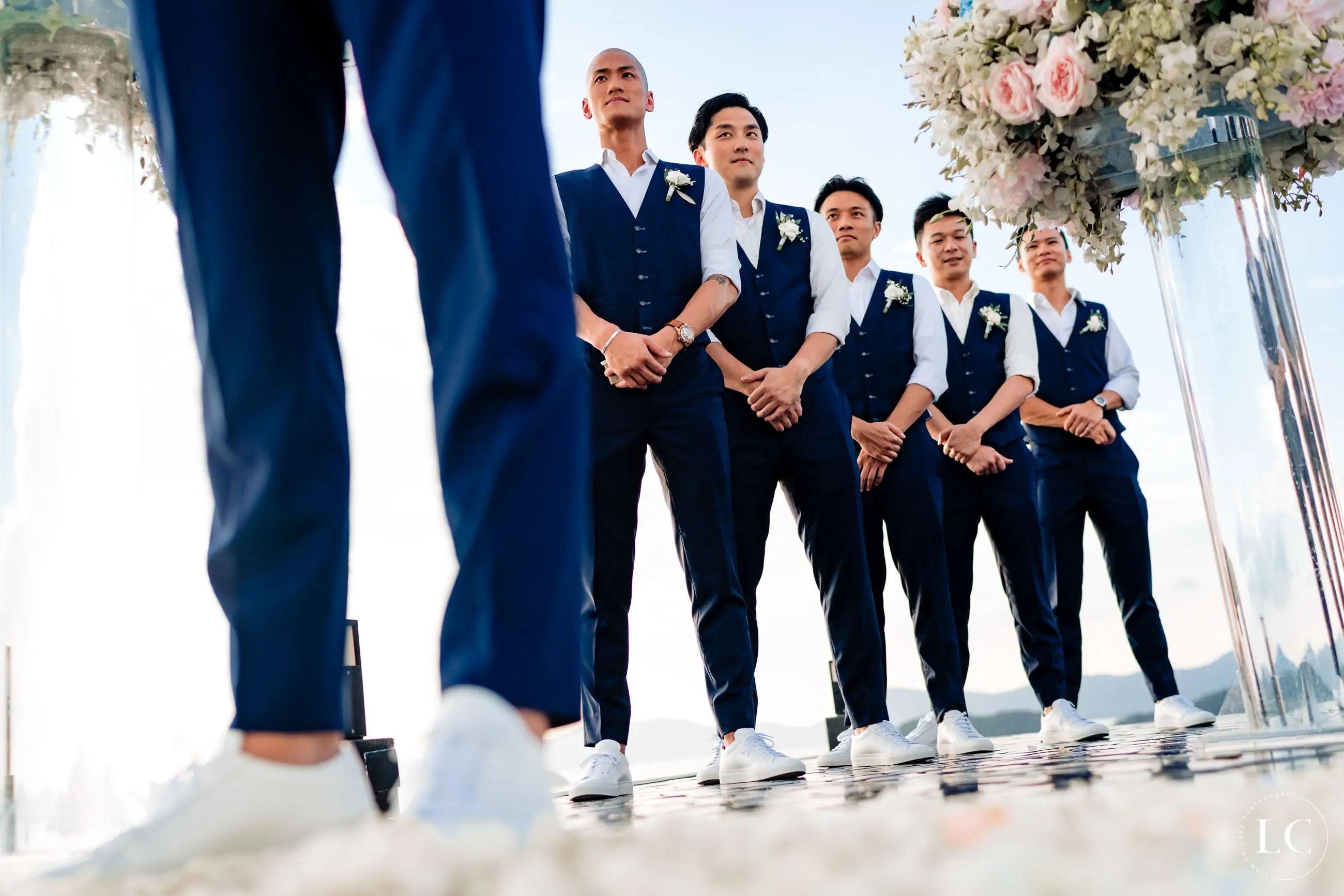 Groomsmen standing at the altar