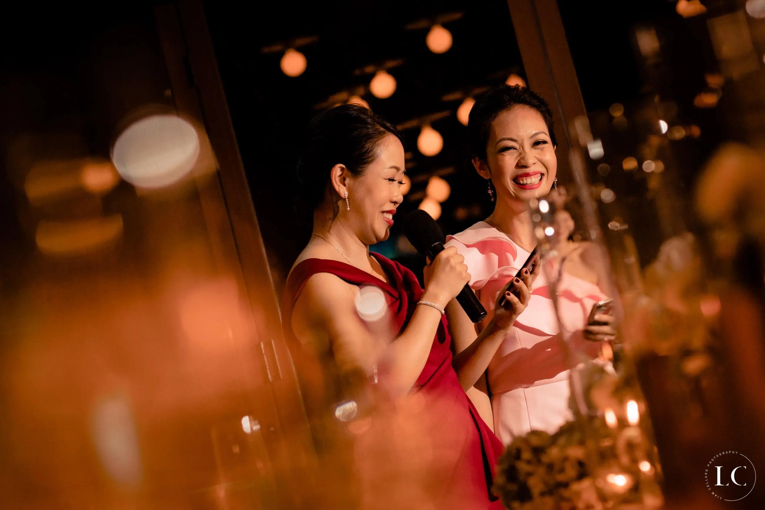 Girls smiling at wedding reception
