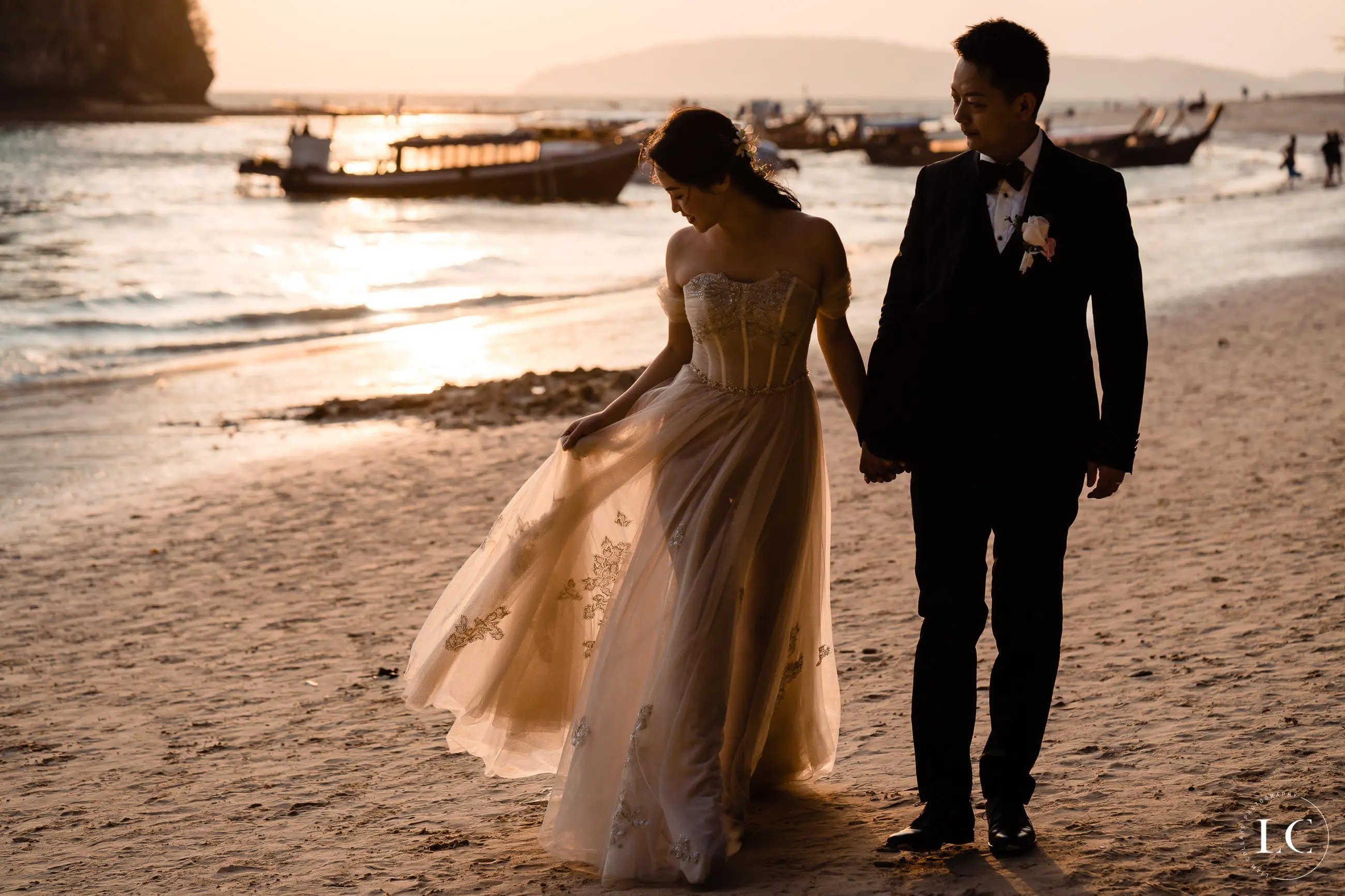 Bride and groom on beach sunset