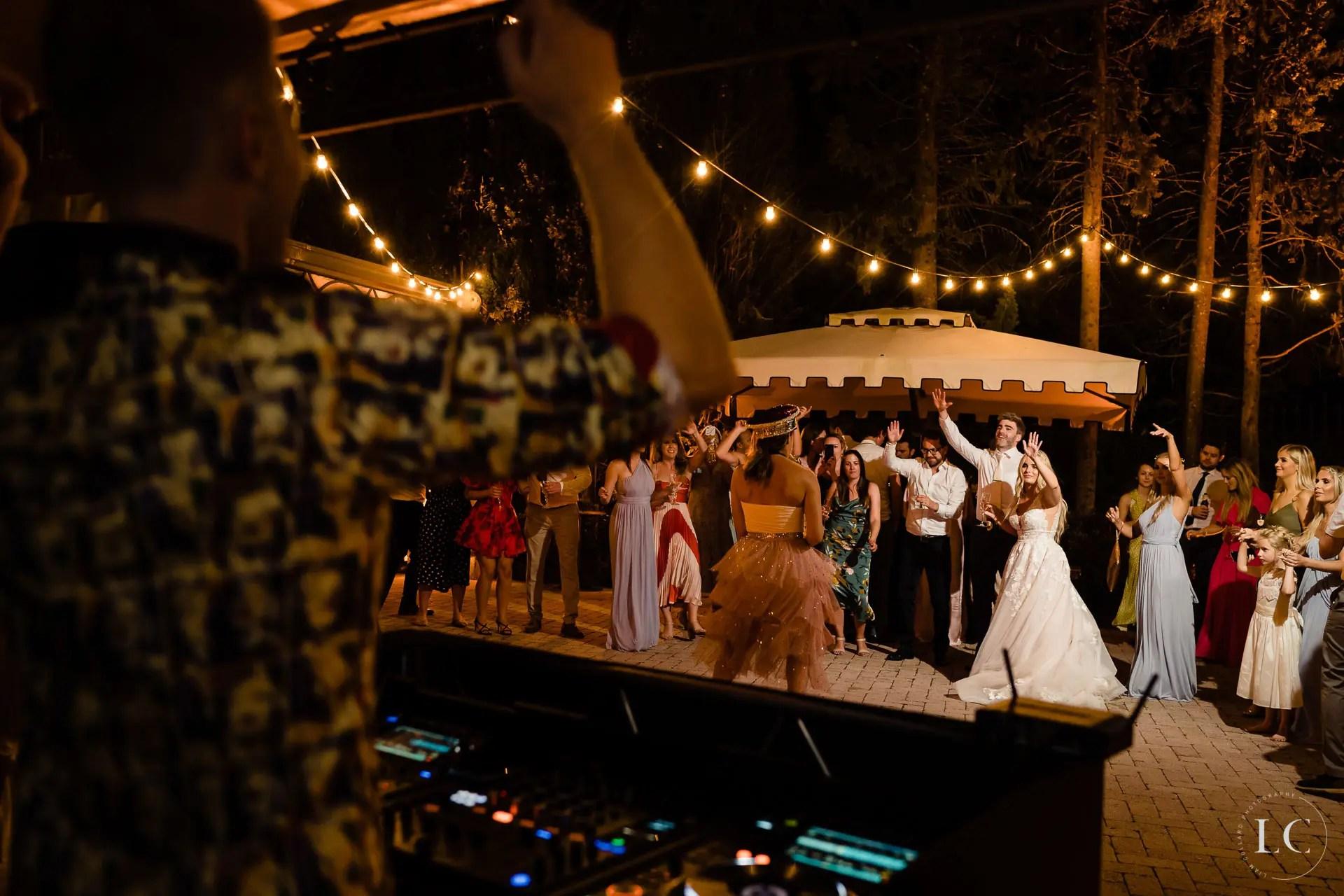 Outside wedding guests dancing