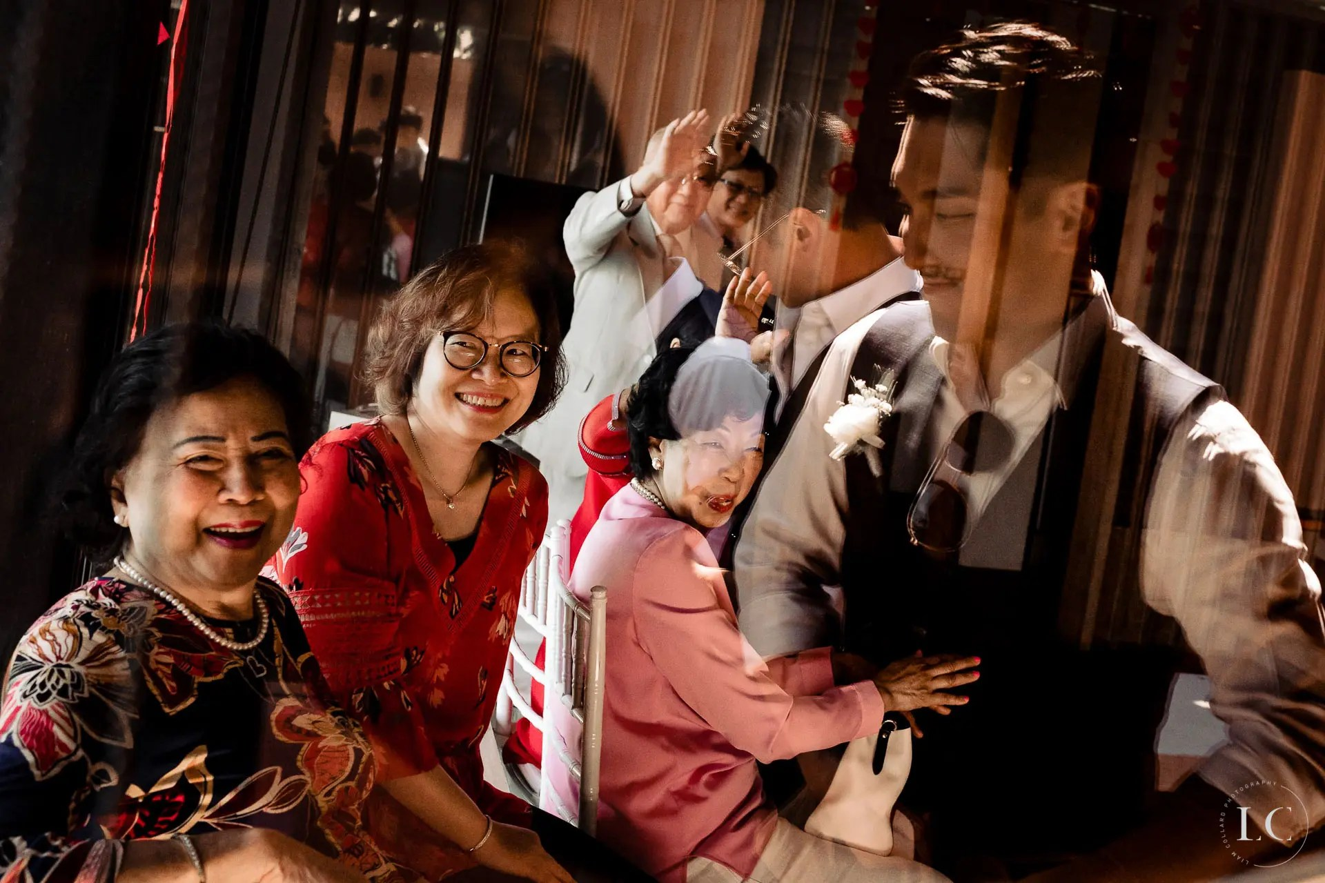 Guests smiling at a wedding