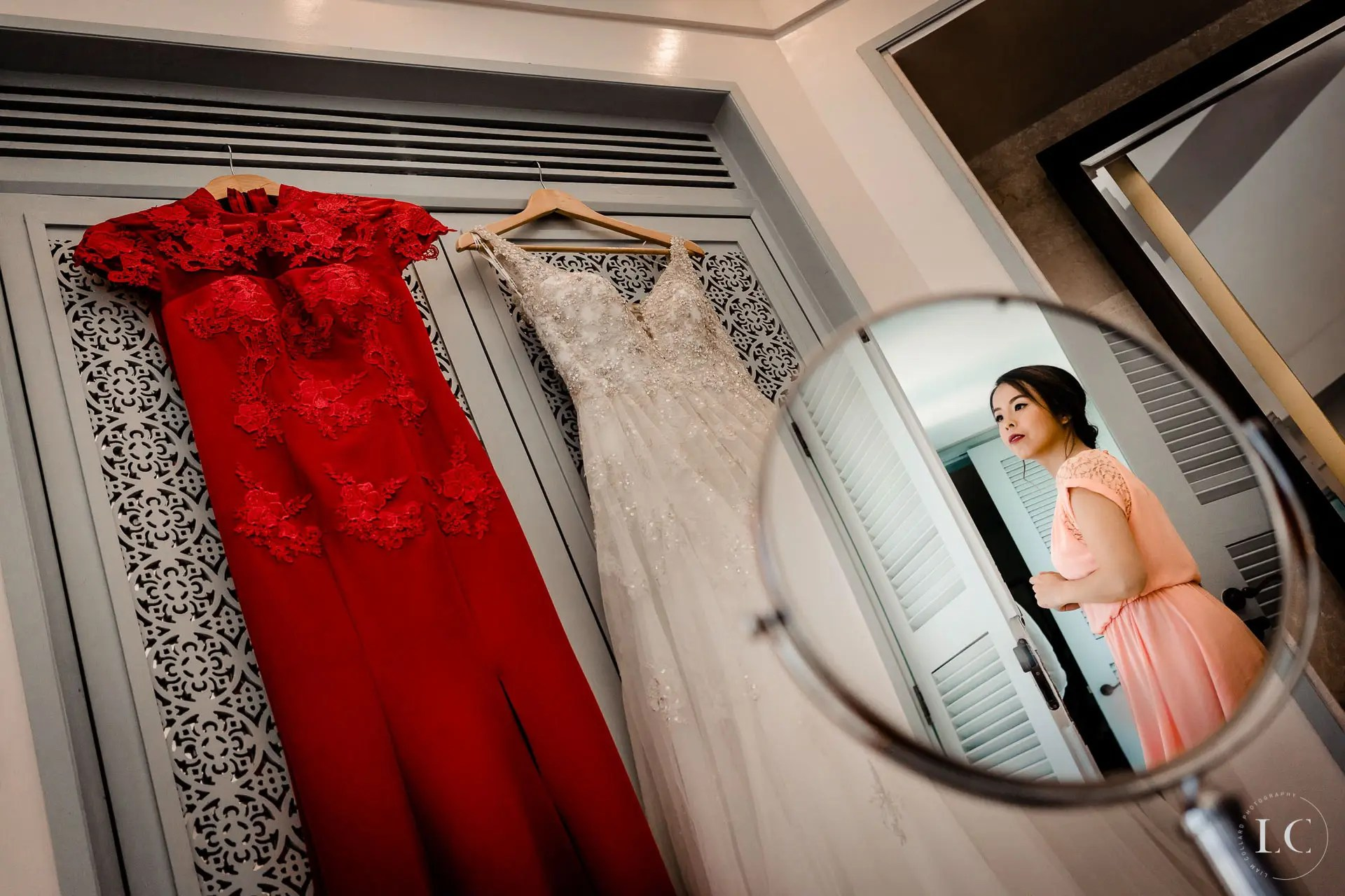 Mirror image of bride getting ready