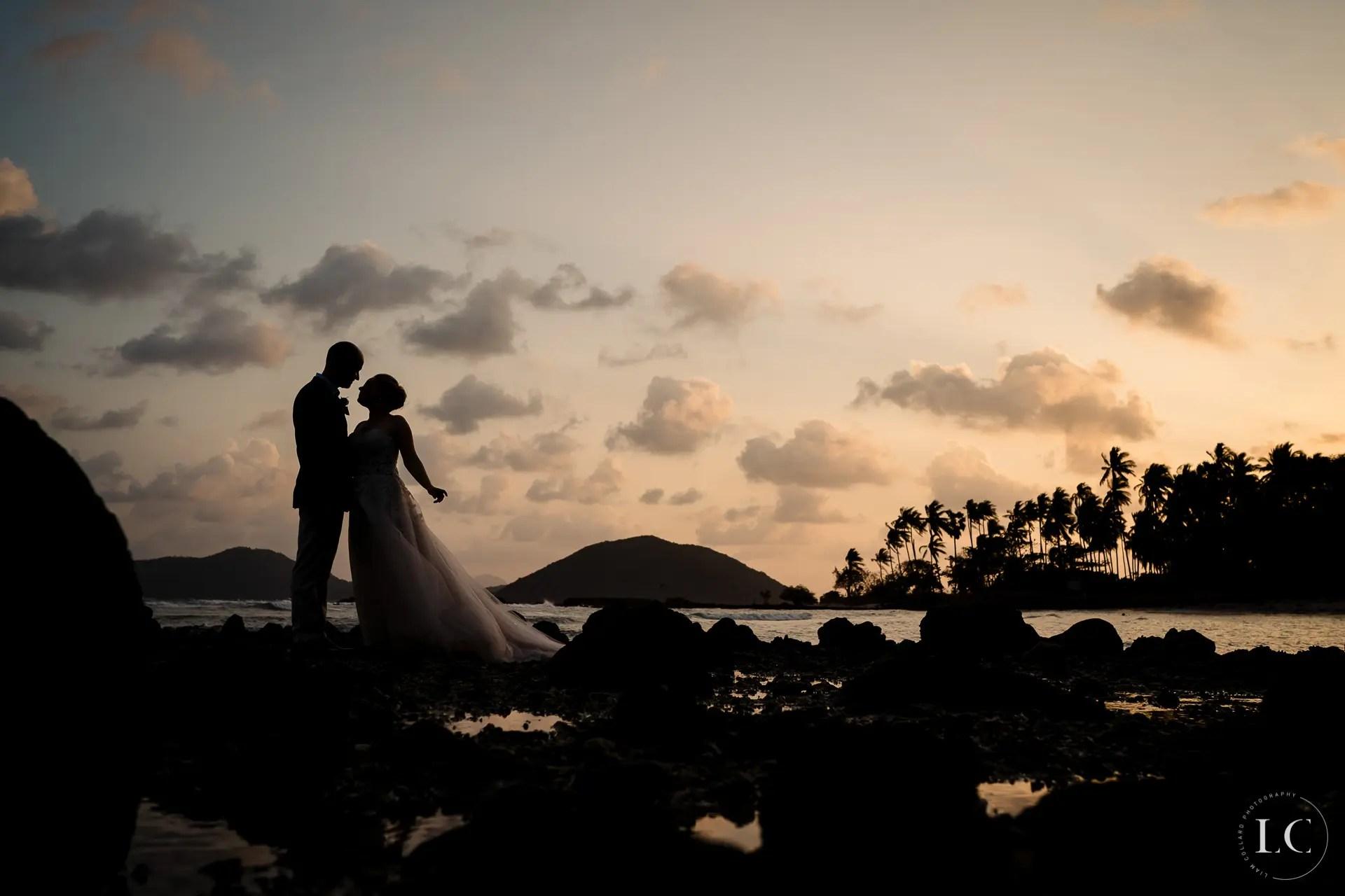 Bride and groom shadows sunset beach