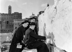 NAC students inspecting an inscription in the Forum, 1954.