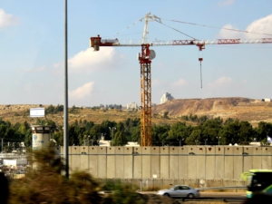 A section of the apartheid wall in Palestine under construction.
